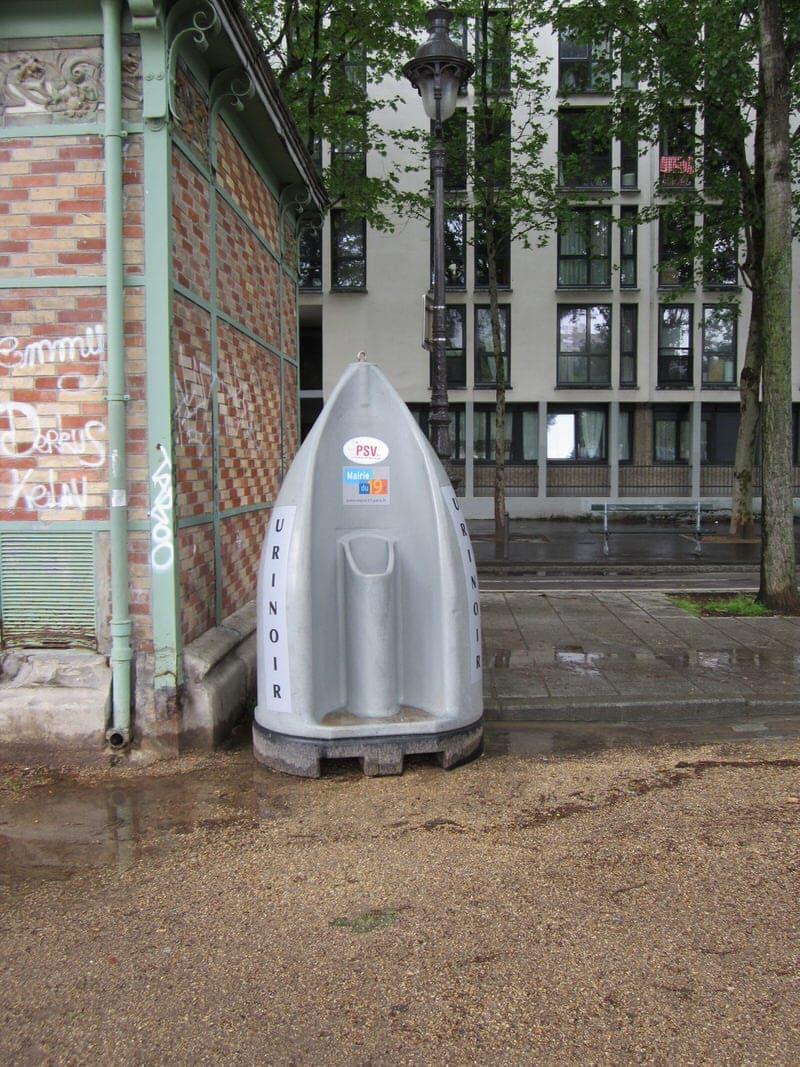 public urinal along Canal Saint Martin Paris