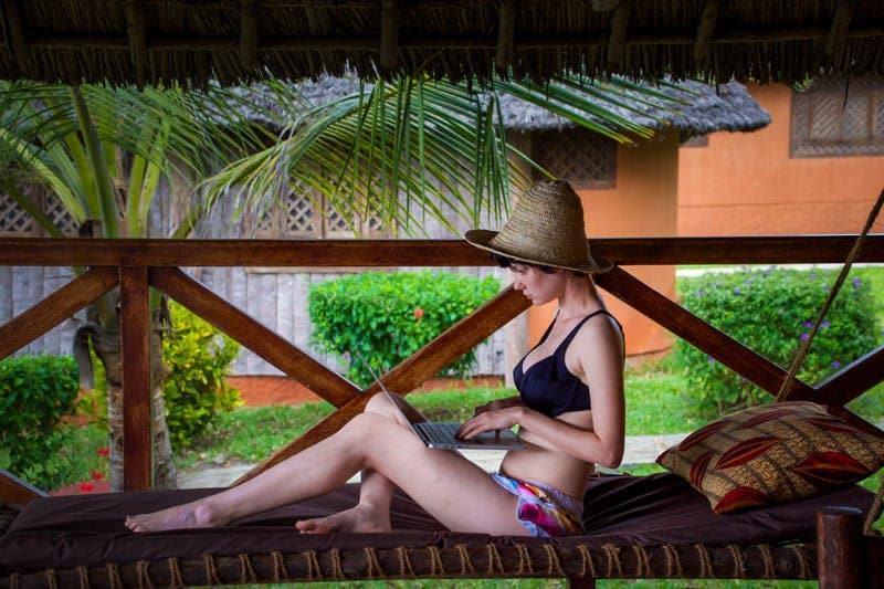 girl using laptop black bikini Netgear Trek