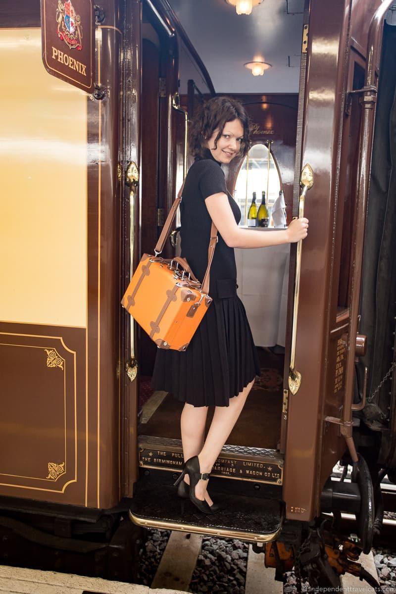 woman boarding British Pullman train