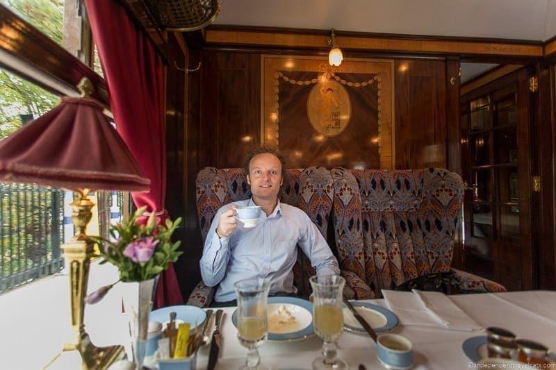 man eating in Ibis British Pullman train