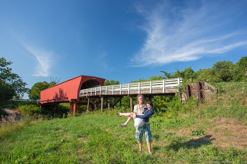 couple lovers at Roseman Bridge covered bridge Madison County Iowa