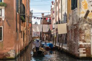 Venice canal doing laundry while traveling travel laundry tips
