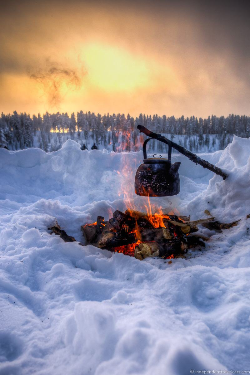 Kettle over campfire Snow winter in Finland winter activities in Finland