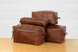 groomsmen gifts toiletry bag dopp kit travel themed wedding destination wedding