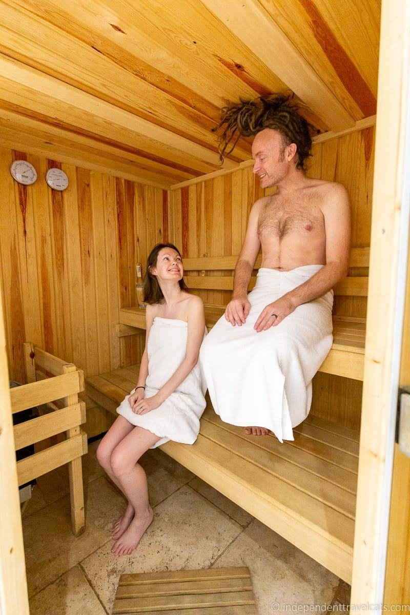 couple in sauna review of Plum Guide vacation rental booking website Somerset holiday homes